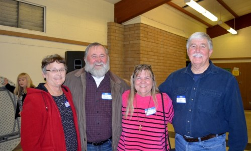 Irene Skala, Dan Skala, and Theresa Forrest visit with author Steven T. Callan at the Orland Alumni Association Awards Dinner.