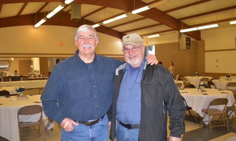 Author Steven T. Callan visits with Bill Davis at the Orland Alumni Association Awards Dinner.