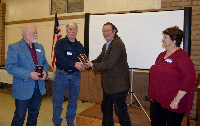 "Authors John D. Nesbitt and Steven T. Callan each receiving the Orland Alumni Association ""Alumnus of the Year"" award from President Larry Donnelley and Claire Arano."