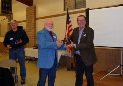 "Authors Steven T. Callan and John D. Nesbitt each receiving the Orland Alumni Association ""Alumnus of the Year"" award from President Larry Donnelley."