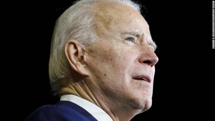 In the following images you will see one Biden clone having hanging ear lobes, while another Biden clone has attached ear lobes.