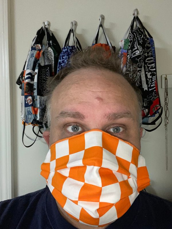 Orange & White Checkerboard Face Mask - This checkerboard face mask that is orange & white will remind you of the endzones of Neyland Stadium at the University of Tennessee. A great face mask to show off that you are a Vols fan.