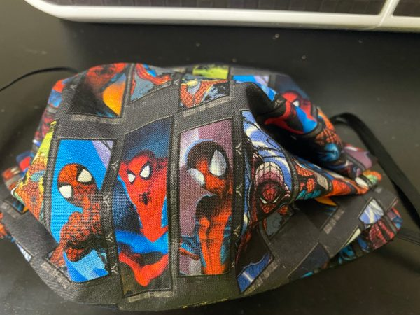 Swatches Spider-Man Face Mask - This Spider-Man face mask has various poses of Spider-Man on it. #SpiderMan