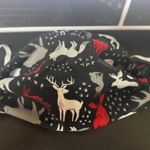 Forest Animals Face Mask - a face mask with forest animals and their tracks.