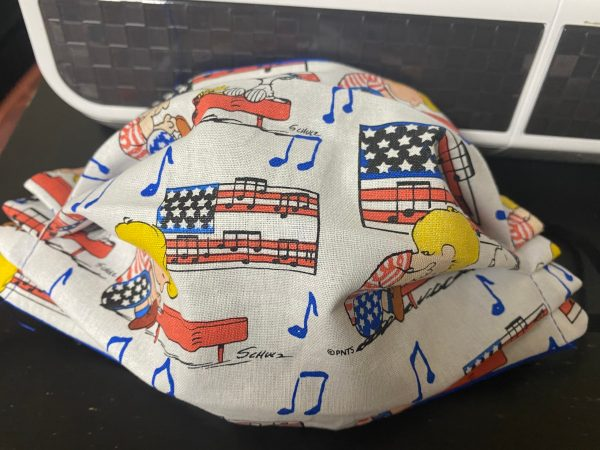 Schroeder, Snoopy and Woodstock Patriotic Face Mask - A patriotic-themed face mask with an American Flag, Piano, Schroeder, Snoopy and Woodstock on it. #Snoopy #Woodstock #Schroeder