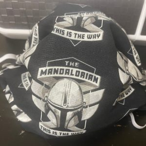 """Mandalorian Helmet Face Mask - This Star Wars Mandalorian face mask has Mondo's helmet on it and the words """"This is the Way"""" on it. #Mandalorian"""