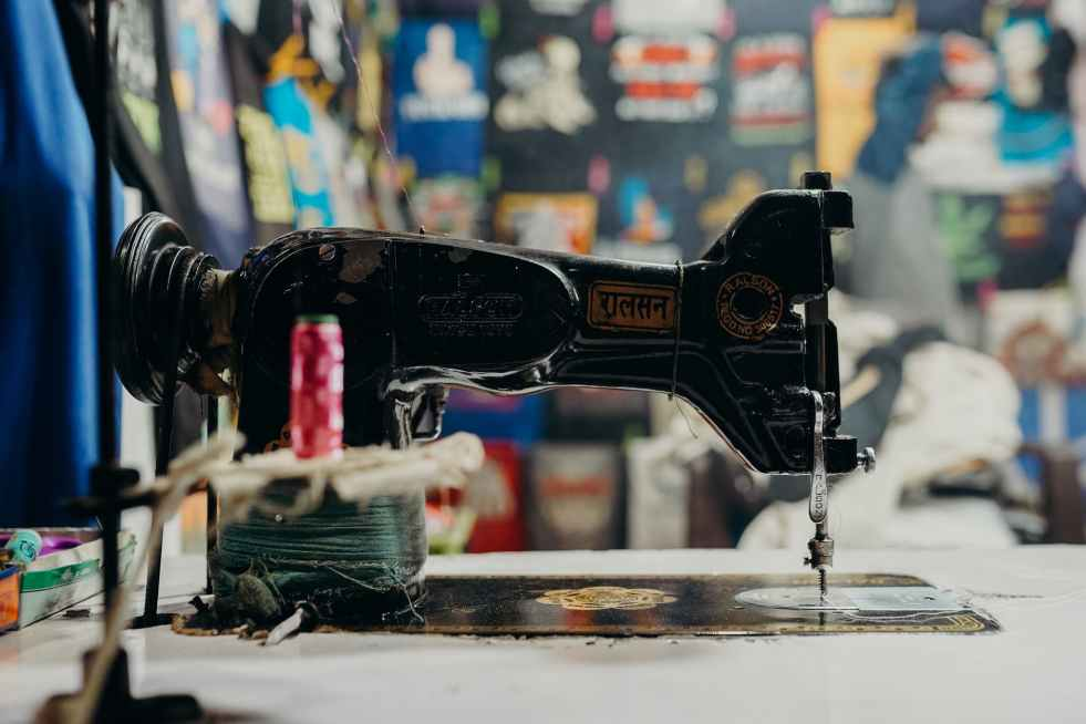 Antique Sewing Machine - National Sewing Machine Day - a day to honor that machine that is used to attach things to together like fabric. #SewingMachineDay (Pexel Photo by CottonBro)