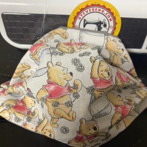 Winnie the Pooh Face Mask - this face mask is based on the Pooh Playing fabric with Winnie the Pooh on it and his honey pots. #Pooh #WinniethePooh #Honey