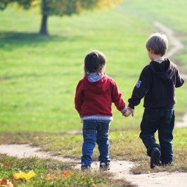 Two Children Walking Down a Path Together
