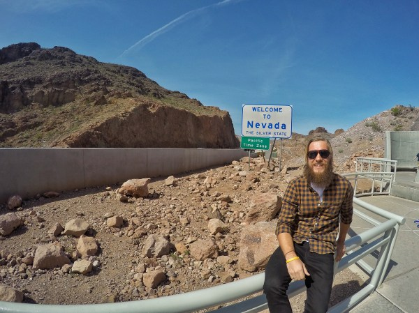 A photo of Stevie Vagabond at the welcome to nevada sign
