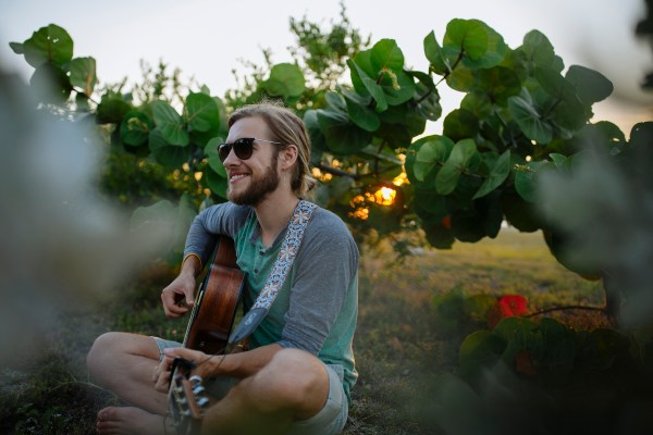 Stevie Vagabond, Musician with guitar and beard at Fort Zachary Taylor Park in Key West, Florida