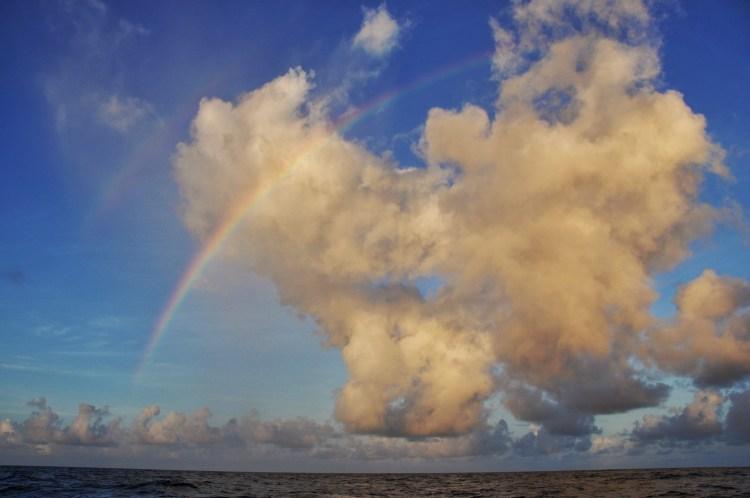 photo of a double rainbow in the caribbean sea