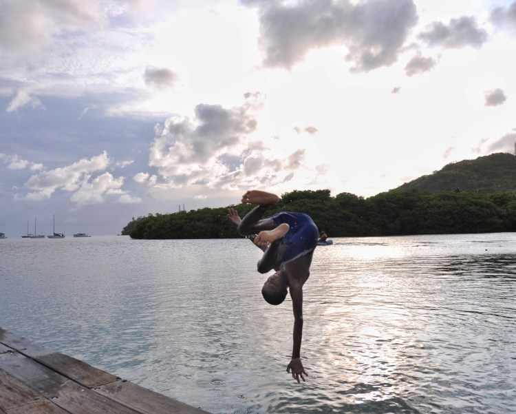 photo of a local colombian boy doing a front flip in Providencia