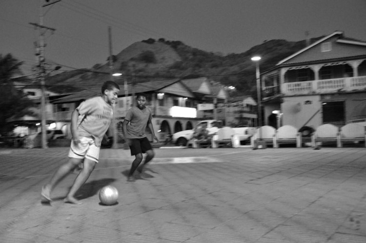 Photo of local colombian boys playing soccer on Providencia