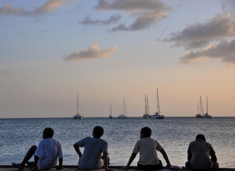 Photo of local colombian boys during sunset on providencia
