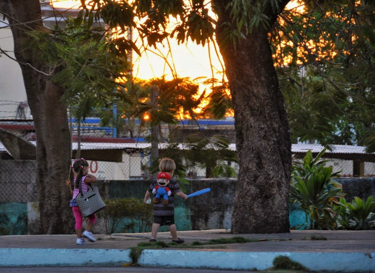 Photo of cuban kids playing in Nueva Gerona during sunset by Stevie Vagabond