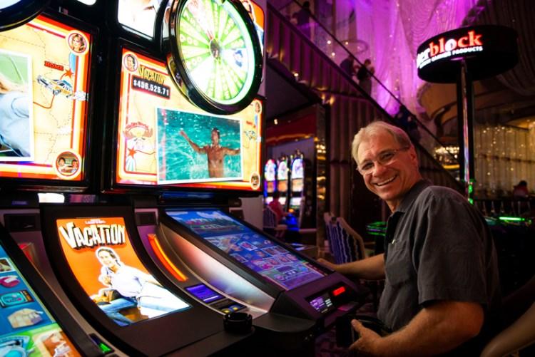 Dad playing the Vegas Vacation slot machine.