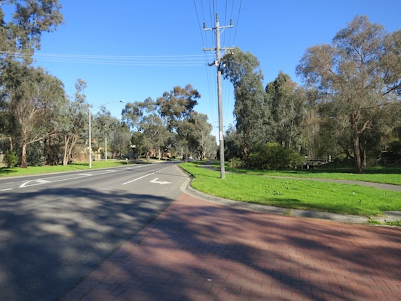 View down the road from entrance to Eltham Gateway Hotel
