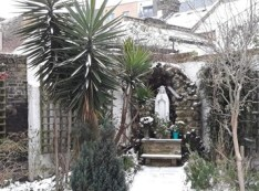 Grotto in Snow