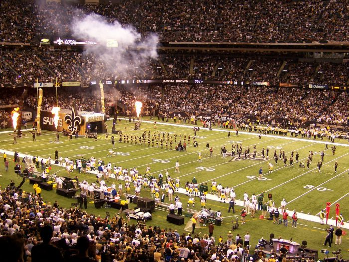 New Orleans Saints players cheerleaders and fans fire display at Mercedes Benz Superdome