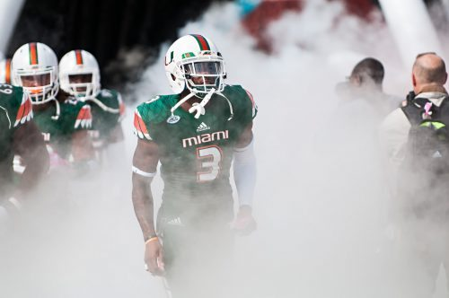 Miami Hurricanes football players entrance with smoke