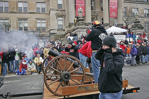 Members of Alpha Sigma Phi fire the cannon Iowa State Cyclones