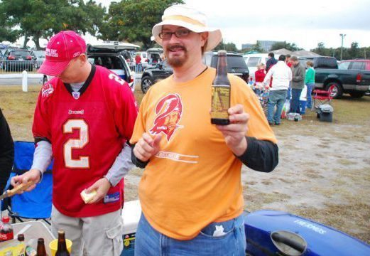 Tampa Bay Buccaneers fans on tailgate party at lot on game day beer bottles