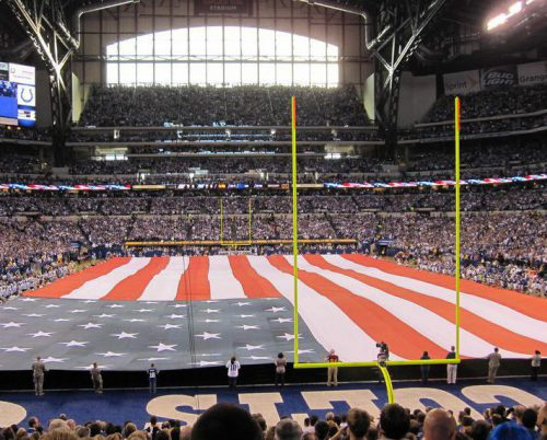 fans participate in US National Anthem at an Indianapolis Colts game in Lucas Oil Stadium