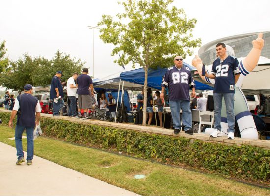 fans tailgating outside AT&T Stadium at Dallas Cowboys game