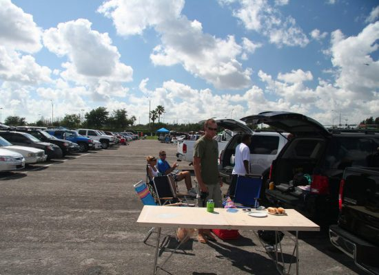 Miami Dolphins fans tailgating at parking lot