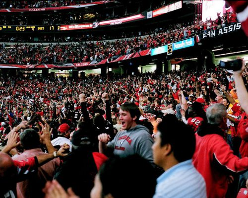 Atlanta Falcons fans cheering at the game