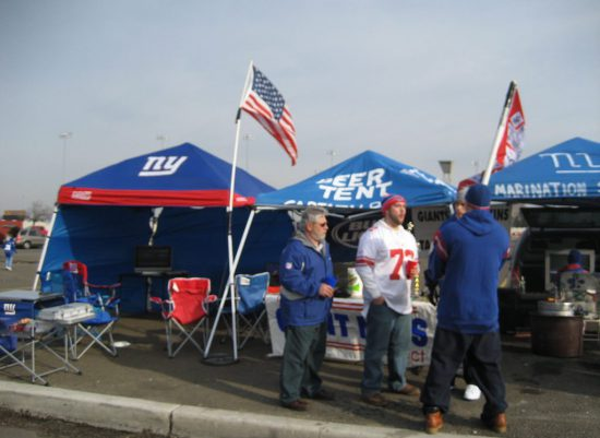 tailgating tents fans at tailgate lot on New York Giants game day