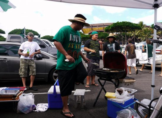 Hawaii Rainbow Warriors fans tailgating at parking lot on football gameday