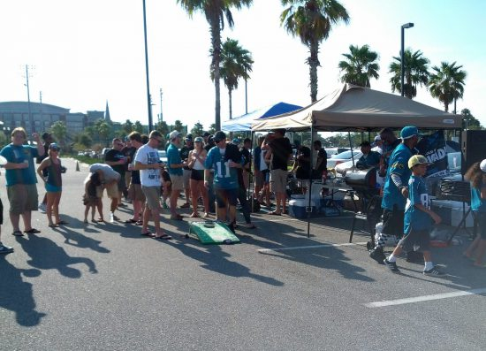 Jacksonville Jaguars tailgaters playing games outside TIAA Bank Field