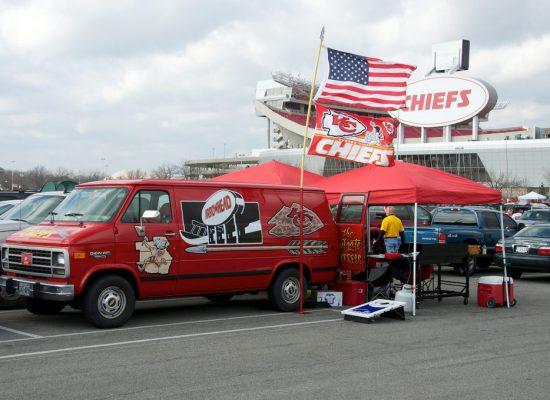 Kansas City Chiefs fans tailgating at Arrowhead Stadium parking lot cornhole