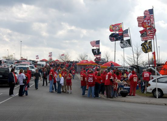 fans tailgating at Kansas City Chiefs game in Arrowhead Stadium parking lot