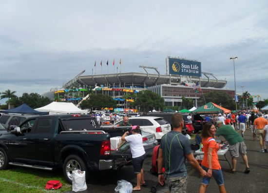 Miami Hurricanes fans at parking lot outside football stadium