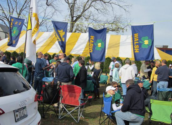 Notre Dame Fighting Irish flags at tailgate lot