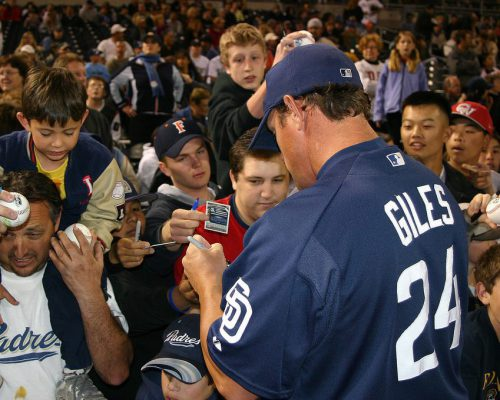 San Diego Padres player signing autographs for fans at Petco Park