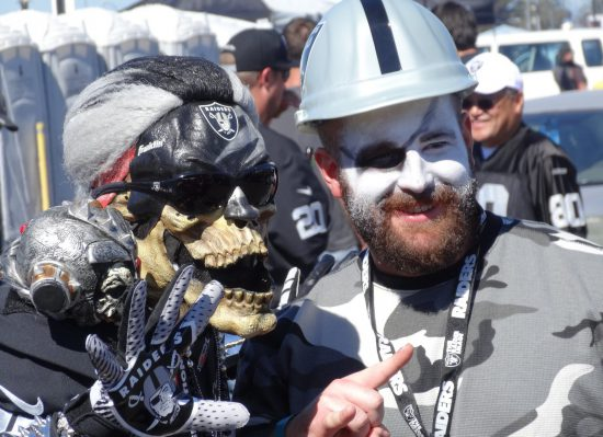 Oakland Raiders fans in costume at the game