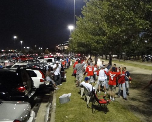 Texas Rangers fans tailgating at night in parking lot