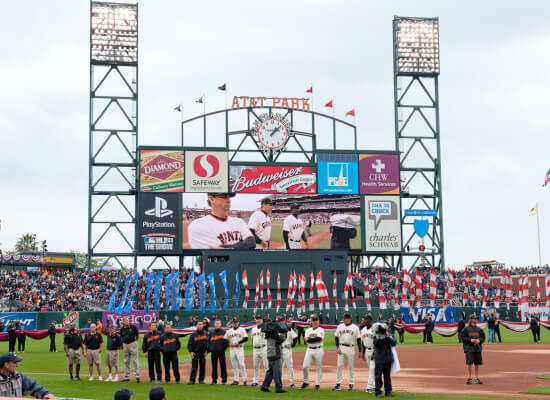 opening day of San Francisco Giants game at Oracle Park scoreboard players
