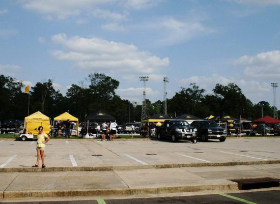 Southern Miss Golden Eagles fans tailgating at parking lot