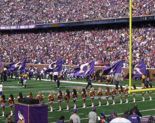Minnesota Vikings game fans cheerleaders flags