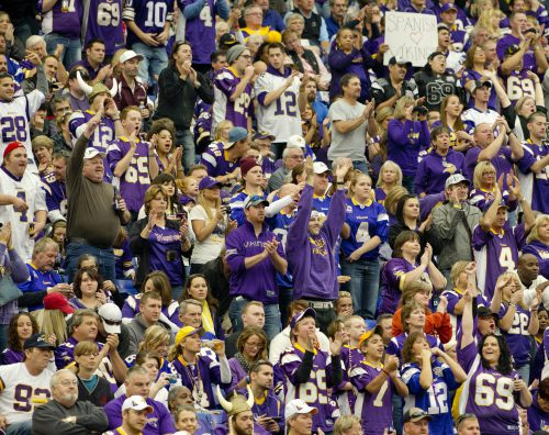 Minnesota Vikings fans cheering at the game