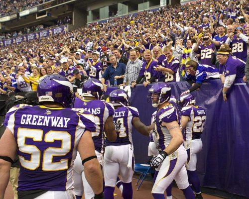 NFL game Minnesota Vikings players greet fans