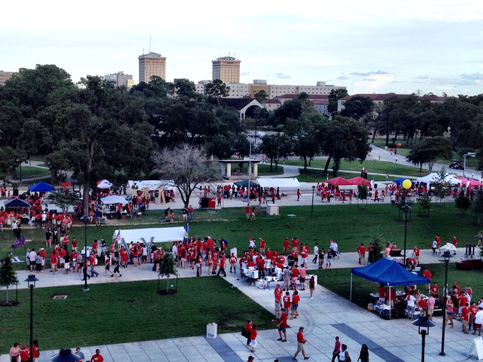 Houston Cougars fans tailgating at Shasta Square on football gameday