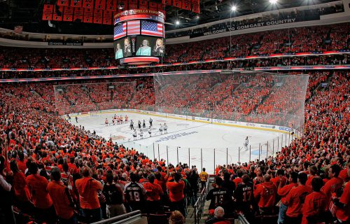 fans stand during God Bless America before the Philadelphia Flyers game
