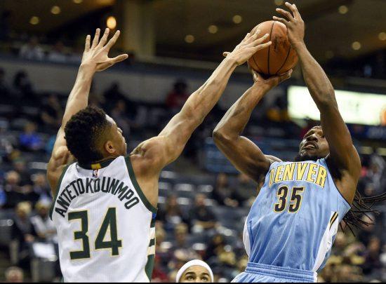 Denver Nuggets basketball player shooting