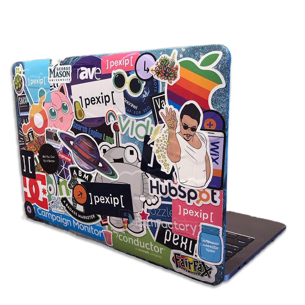 Macbook with stickers on it